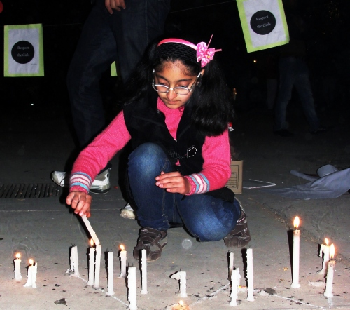 Girl lighting candle